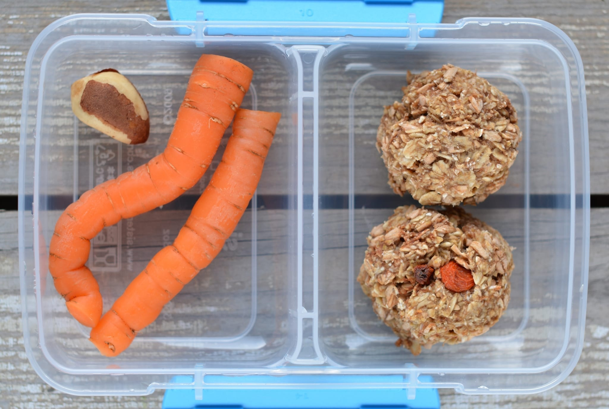 Snack box with carrots, cookies and a nut