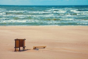 Deserted beach, bench on the beach