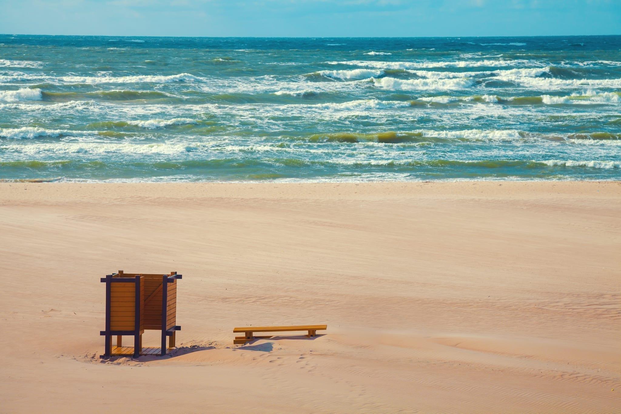 Deserted beach, bench on the beach